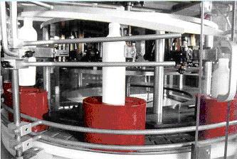 袴(パック/ホールディングカップ)への容器挿入機